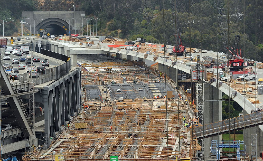 . From 525 feet up on the new Bay Bridge eastern span tower July 13, 2012, progress of  the Yerba Buena tie-in shows one of the two sections of the bridge\'s roadway yet to be finished as crews race to complete the span for its anticipated Labor Day 2013 opening. The other uncompleted roadway section is at the Oakland shoreline. (Karl Mondon/Staff)