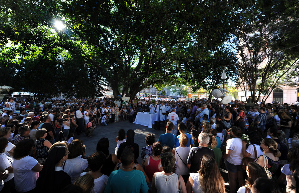 Description of . Santa Maria residents attend a multi-religion mass in tribute to the fire victims, at the Saldanha Marinho square on January 28, 2013, in Santa Maria, southern Brazil, where a blaze on the eve at a nightclub killed more than 230 people. Brazilian police arrested four suspects --two of the Kiss club's owners, along with a pair of musicians who starred in the ill-fated pyrotechnic show, in the wake of the nightclub fire that forced sports officials to defend preparations for the World Cup and Olympics.  ANTONIO SCORZA/AFP/Getty Images