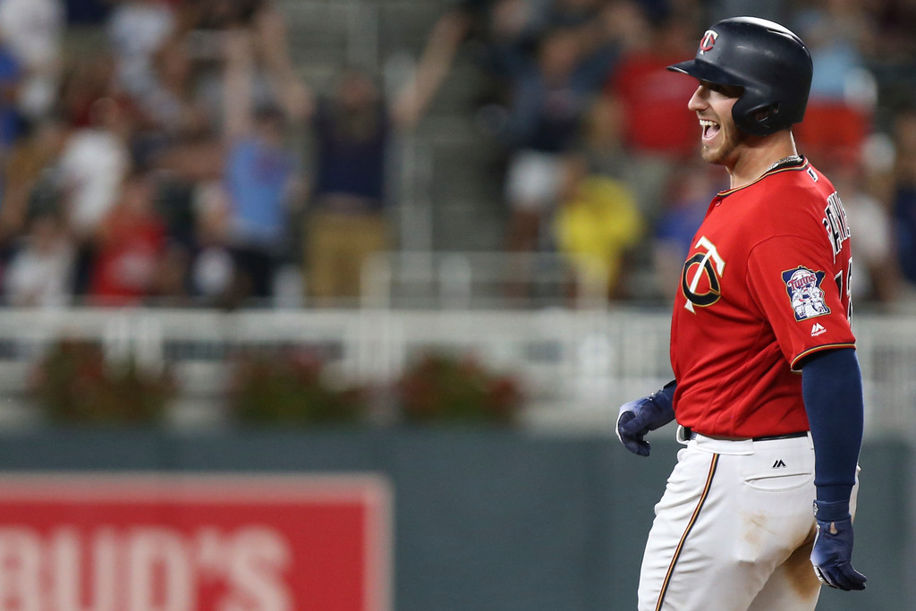 . Minnesota Twins\' Mitch Garver smiles after hitting a fly ball to make a double in the ninth inning to win against the Cleveland Indians in a baseball game Monday, July 30, 2018 in Minneapolis. Minnesota won 5-4. (AP Photo/Stacy Bengs)