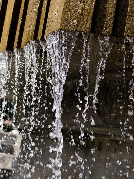 An upclose shot of a man made waterfall taken in Anchorage Alaska