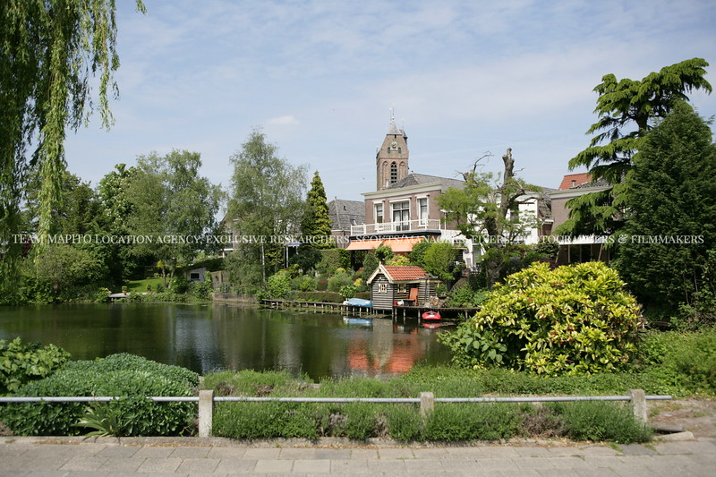 Scenic village view with pond and church