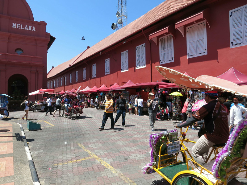 Hawker stalls and tri-shaws at Dutch Square