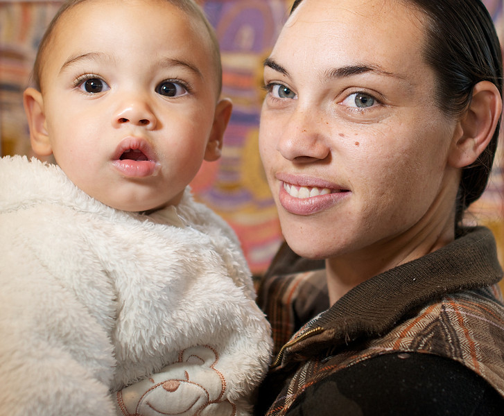Indigenous Australian Woman holding her one-year-old Baby