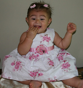 Destiny, 10 months old in a pretty pink dress