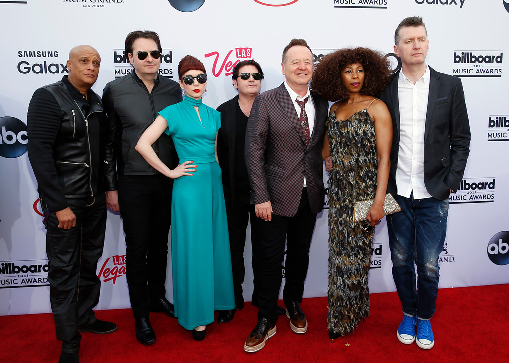 . The musical group Simple Minds, from left, Mel Gaynor, Andrew Gillespie, Catherine Davies, Charlie Burchill, James Kerr, Sarah Brown, and Gerard Grimes, arrive at the Billboard Music Awards at the MGM Grand Garden Arena on Sunday, May 17, 2015, in Las Vegas. (Photo by Eric Jamison/Invision/AP)