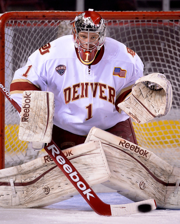 . DENVER, CO. - FEBRUARY 21, 2014: Denver goalie Sam Brittain fielded shots before the game. The University of Denver hockey team hosted Colorado College at Magness Arena Friday night, February 21, 2014. Photo By Karl Gehring/The Denver Post