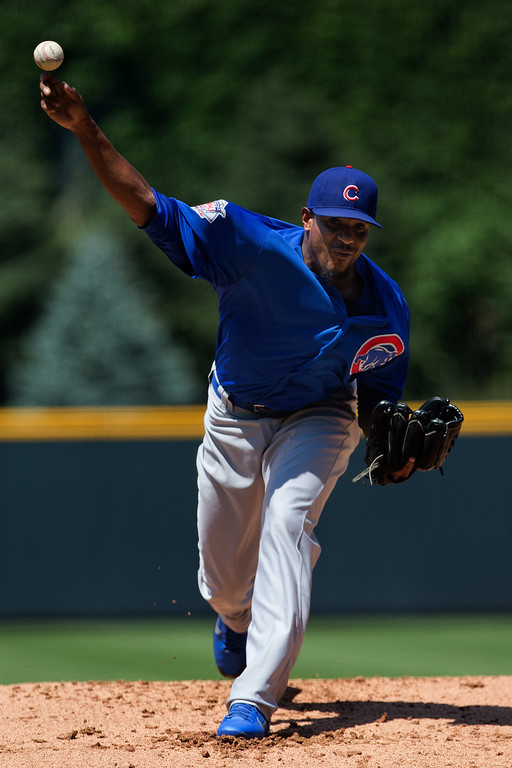 . Starting pitcher Edwin Jackson #36 of the Chicago Cubs delivers to home plate during the first inning against the Colorado Rockies at Coors Field on July 21, 2013 in Denver, Colorado. (Photo by Justin Edmonds/Getty Images)