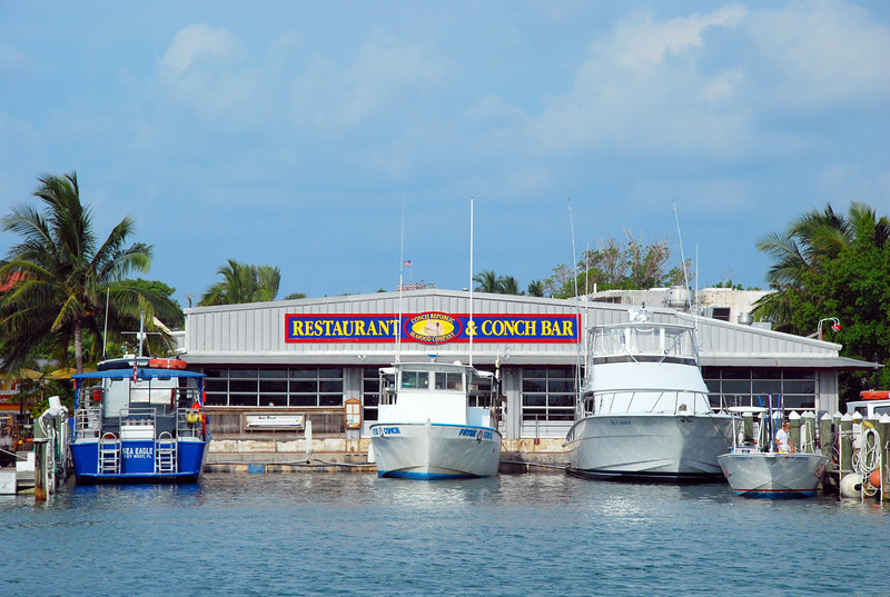 The Conch Republic Restaurant and Bar in the Key West Bight.  The fishing boats back up to the door to deliver fresh fish!