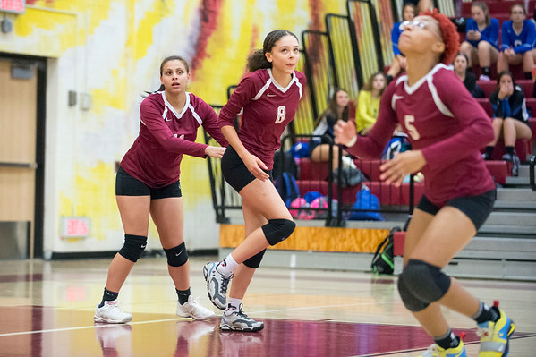 09/16/19 Wesley Bunnell | StaffrrNew Britain volleyball player Nataly Hernandez (11), Maleah Echevarria (8) watch as Raven Symone-Jarrett (5) chases a ball that goes out of bounds.