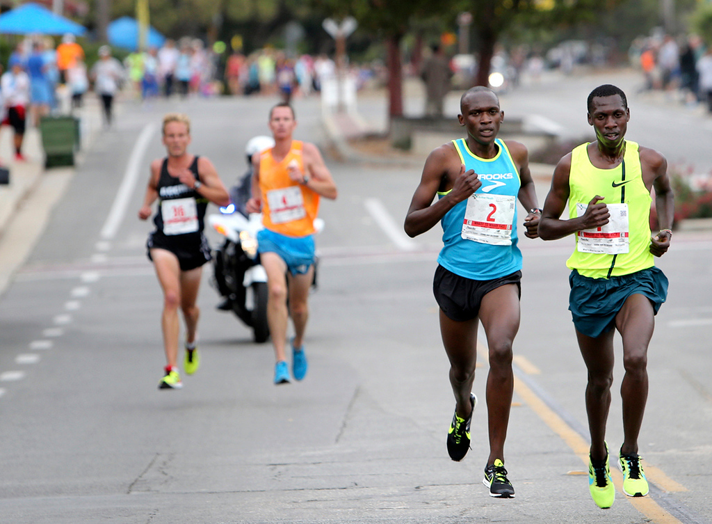 . Nelson Oyugi, left, and Wharf to Warf winner Simon Ndirangu are cheered-on by the crowds as they compete in the annual race on Sunday. (Kevin Johnson -- Santa Cruz Sentinel)