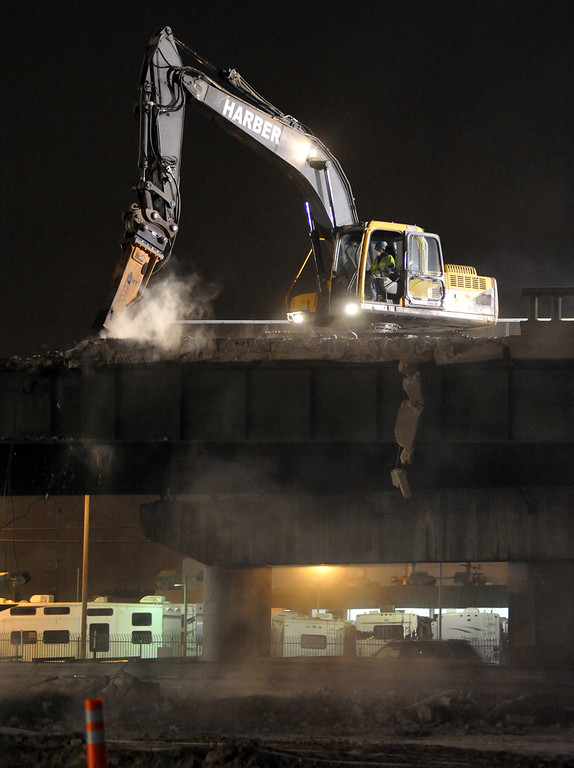 . Caltrans and contractors work to demolish the Alondra Bridge over the Santa Ana (I-5) Freeway early Saturday morning June 15, 2013. Traffic was closed on the northbound lanes as the surface of that side of the bridge is removed. The northbound steel girders are expected to be removed Sunday. (SGVN/Staff Photo by Keith Durflinger)