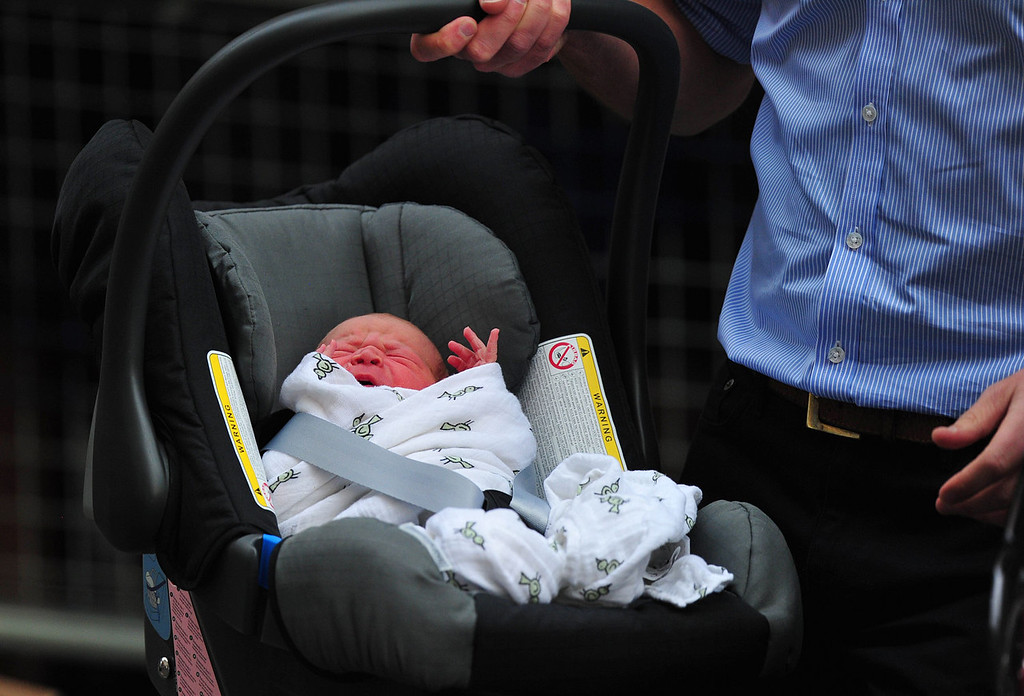 . Prince William and Catherine, Duchess of Cambridge\'s new-born baby boy is introduced to the world\'s media outside the Lindo Wing of St Mary\'s Hospital in London on July 23, 2013. The baby was born on Monday afternoon weighing eight pounds six ounces (3.8 kilogrammes). The baby, titled His Royal Highness, Prince (name) of Cambridge, is directly in line to inherit the throne after Charles, Queen Elizabeth II\'s eldest son and heir, and his eldest son William.   CARL COURT/AFP/Getty Images