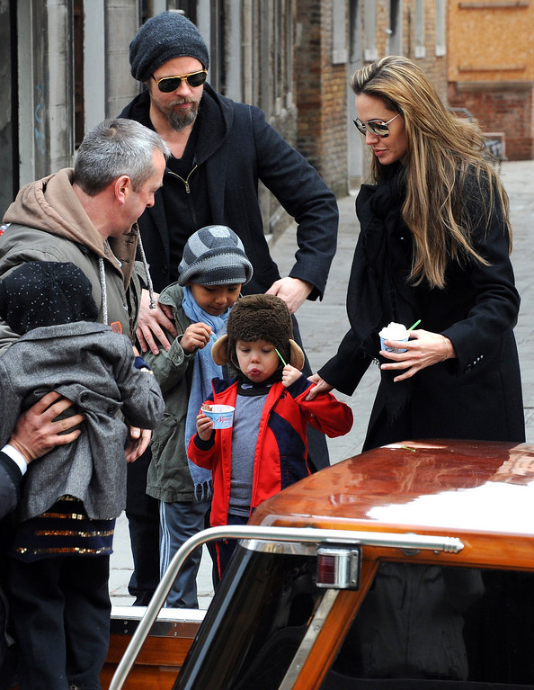 """. Actors Angelina Jolie, right, and Brad Pitt, second left,are seen with children Maddox, left, Shiloh Nouvel, in Venice, Tuesday, Feb. 16, 2010. Angelina Jolie is in Venice to shoot scenes of the movie \""""The Tourist\"""", by director Florian Henckel von Donnersmarck. (AP Photo/Luigi Costantini)"""