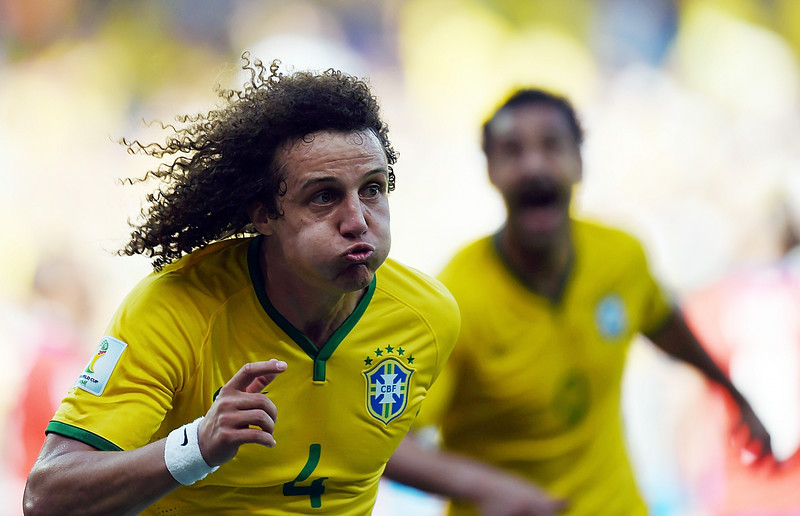 . Brazil\'s defender David Luiz celebrates after scoring a goal during the round of 16 football match between Brazil and Chile at The Mineirao Stadium in Belo Horizonte during the 2014 FIFA World Cup on June 28, 2014.  (VANDERLEI ALMEIDA/AFP/Getty Images)