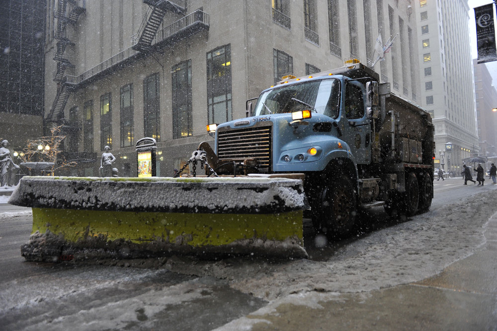 Description of . A City of Chicago snow plow pushes the slush off the road on March 5, 2013 in Chicago, Illinois. The worst winter storm of the season is expected to dump 7-10 inches of snow on the Chicago area with the worst expected for the evening commute.  (Photo by Brian Kersey/Getty Images)