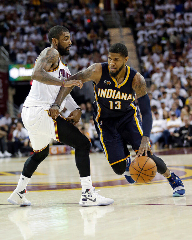 . Indiana Pacers\' Paul George (13) drives past Cleveland Cavaliers\' Kyrie Irving (2) in the second half of Game 1 of a first-round NBA basketball playoff series, Saturday, April 15, 2017, in Cleveland. The Cavaliers won 109-108. (AP Photo/Tony Dejak)