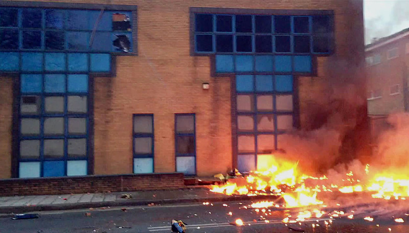 . A stills grab from television footage taken by a member of the public shows flames on a road following the crash of a helicopter in central London, on January 16, 2013. Two people were killed when a helicopter hit a crane at a building site in central London and plunged to the ground on Wednesday, police said.   NIC WALKER/AFP/Getty Images