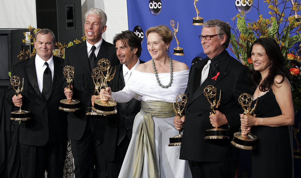 """. Cast and producers including Al Pacino, third from left, Meryl Streep, third from right, and Mike Nichols, second from right, hold the award for outstanding miniseries for their work on \""""Angels In America,\"""" at the 56th Annual Primetime Emmy Awards Sunday, Sept. 19, 2004, at the Shrine Auditorium in Los Angeles.   (AP Photo/Mark J. Terrill)"""