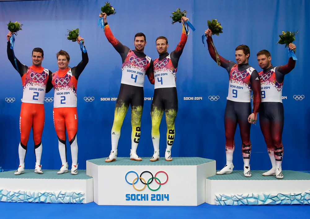 . Gold medallists Tobias Wendl (3rdL) and Tobias Arlt (3rdR) of Germany celebrate during the flower ceremony with silver medallists Andreas Linger (L) and Wolfgang Linger (2ndL) of Austria and bronze medallists Andris Sics and Juris Sics (R) of Latvia after the Men\'s Luge Doubles on Day 5 of the Sochi 2014 Winter Olympics at Sliding Center Sanki on February 12, 2014 in Sochi, Russia.  (Photo by Ezra Shaw/Getty Images)