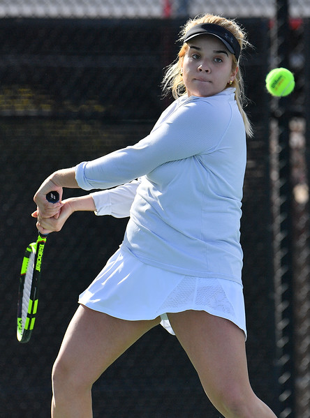 LAS VEGAS, NV - JANUARY 20:  Vanessa Valdez of the New Mexico State Aggies plays a backhand during her match against Caitlin Herb of the Weber State Wildcats at the Frank and Vicki Fertitta Tennis Complex in Las Vegas, Nevada. Herb won the match 6-4, 7-6 (10-5)