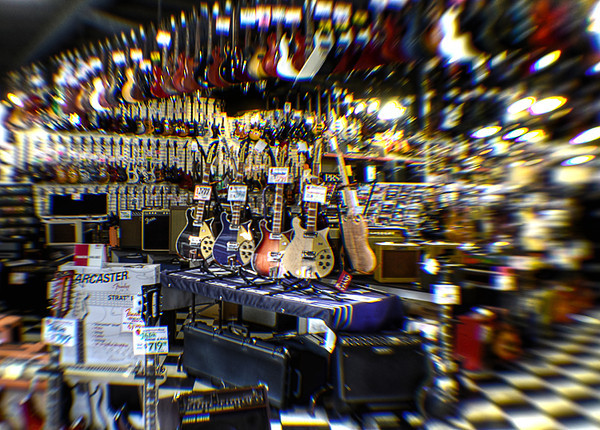 0326 many  Many, many guitars.