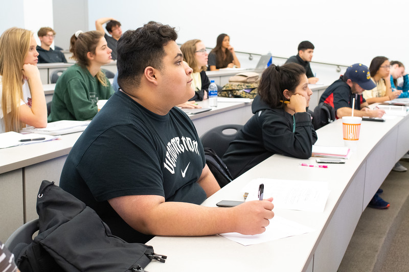 Aaron Rodriguez taking notes in his College Algebra class.