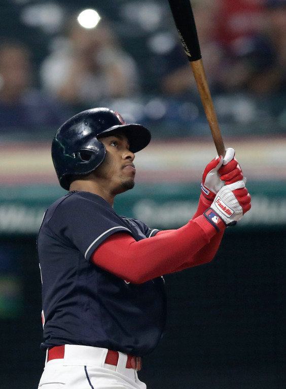 . Cleveland Indians\' Francisco Lindor watches his solo home run off Minnesota Twins relief pitcher Trevor Hildenberger during the eighth inning of a baseball game, Tuesday, Aug. 7, 2018, in Cleveland. (AP Photo/Tony Dejak)