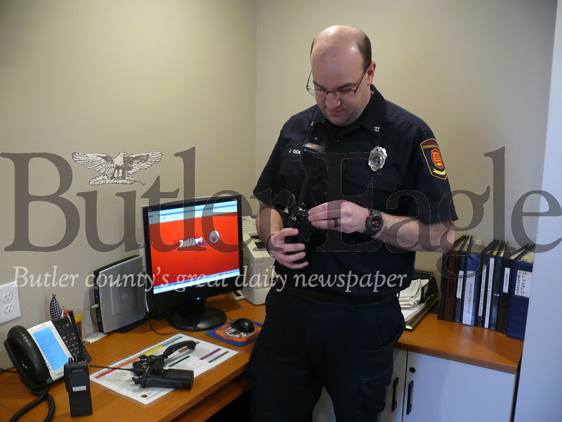 Jeff Gooch, fire risk reduction coordinator with the Cranberry Township Volunteer Fire Department, shows off new radios being used by the department.