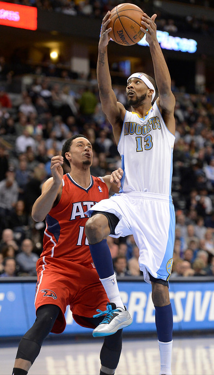 . Corey Brewer (13) of the Denver Nuggets drives on John Jenkins (12) of the Atlanta Hawks during the first quarter March 4,  2013 at Pepsi Center. (Photo By John Leyba/The Denver Post)