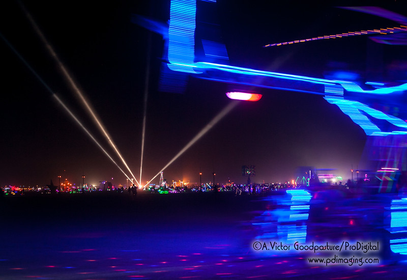 What makes Burning Man at night so unique is the lit up art cars that cross the playa, along with thousands of lit up bicylces.