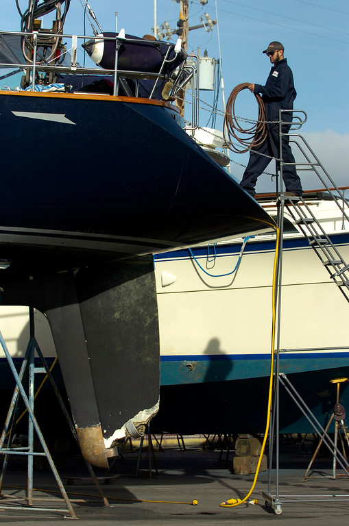 . A damaged rudder is seen as a worker boards the Darling at the Bay Marine Boatworks yard in Richmond, Calif. on Tuesday, March 5, 2013. The Darling was stolen from a Sausalito marina, then ran aground in Pacifica on Monday. (Kristopher Skinner/Staff)