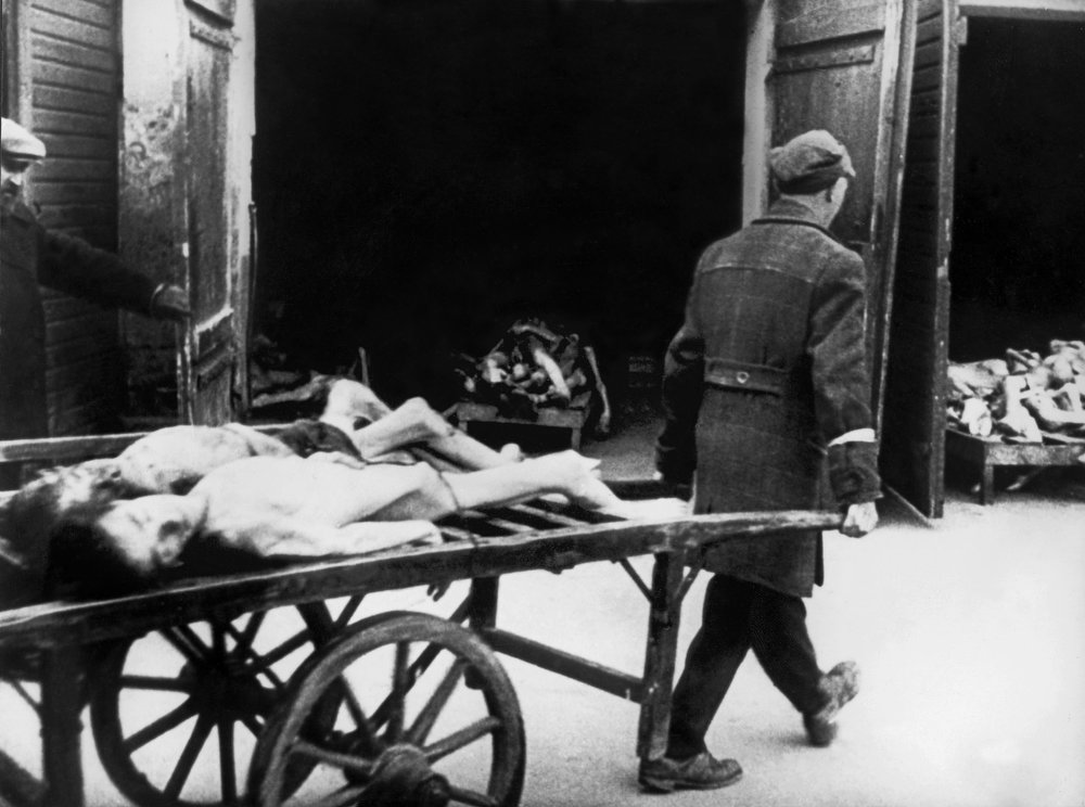 . A man carries away the bodies of dead Jews in the Ghetto of Warsaw in 1943, where people began to die of hunger in the streets. Every morning, about 4-5 a.m., funeral carts collected a dozen or more corpses on the streets. The bodies of the dead Jews were cremated in deep pits. On April 19, 1943 the Warsaw ghetto uprising began after German troops and police entered the ghetto to deport its surviving inhabitants. Seven hundred and fifty fighters fought for nearly a month. But on May 16, 1943, the revolt ended the Germans had slowly crushed the resistance. Of the more than 56,000 Jews captured, about 7,000 were shot, and the remainder were deported to killing centers or concentration camps. (AFP/Getty Images)