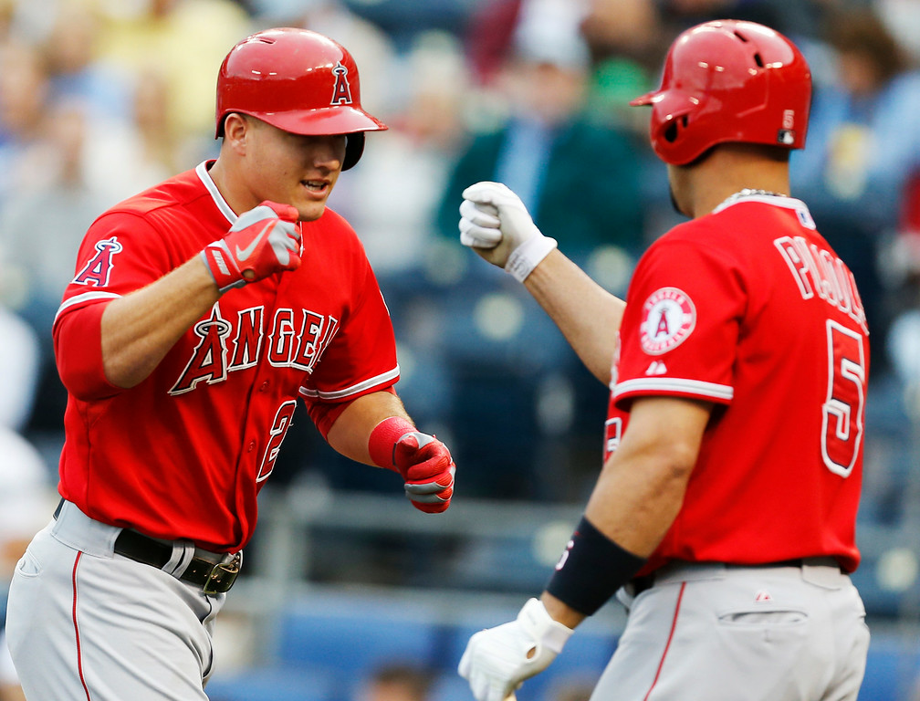 . Los Angeles Angels\' Mike Trout (27) fist bumps with teammate Albert Pujols (5) after his solo home run in the first inning of a baseball game against the Kansas City Royals at Kauffman Stadium in Kansas City, Mo., Thursday, May 23, 2013. (AP Photo/Orlin Wagner)