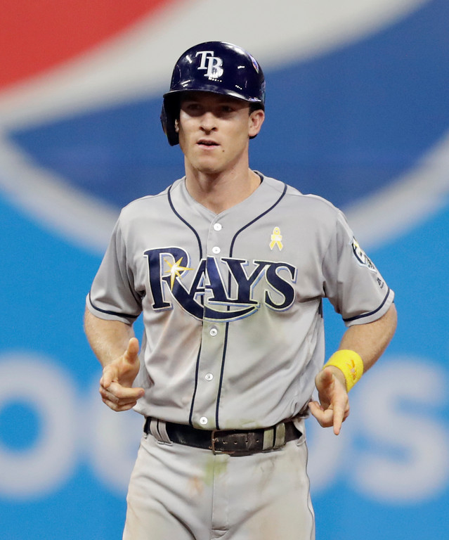 . Tampa Bay Rays\' Joey Wendle reacts after hitting a double in the sixth inning of a baseball game against the Cleveland Indians, Saturday, Sept. 1, 2018, in Cleveland. (AP Photo/Tony Dejak)