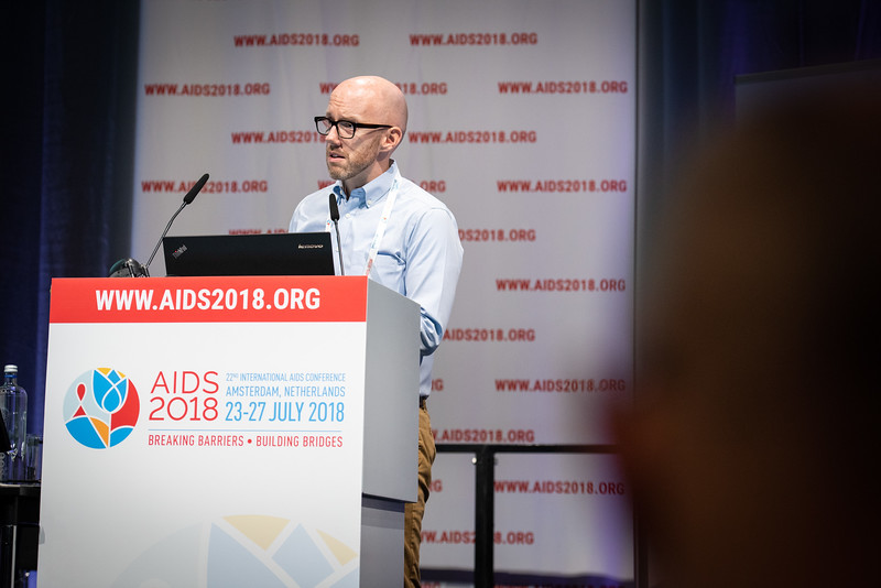 22nd International AIDS Conference (AIDS 2018) Amsterdam, Netherlands.   Copyright: Steve Forrest/Workers' Photos/ IAS  Photo shows: Owen Ryan, IAS Executive Director, delivering the IAS Secretariat update during the IAS Members' Meeting.