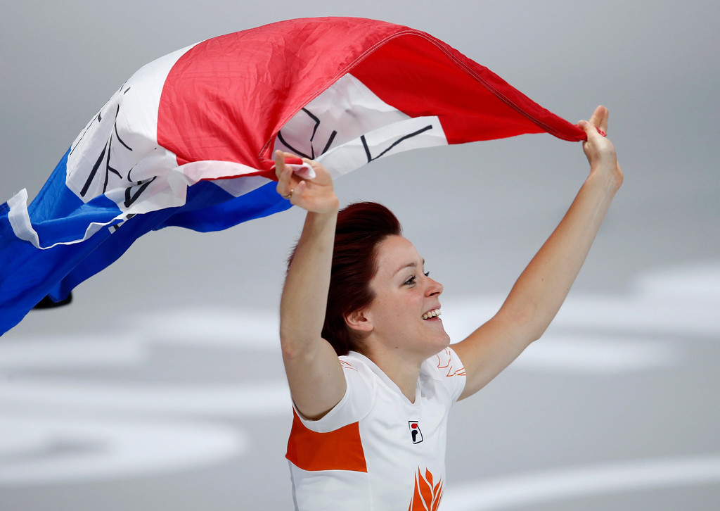 . Gold medallist Jorien ter Mors of The Netherlands celebrates with the national flag after the women\'s 1,000 meters speedskating race at the Gangneung Oval at the 2018 Winter Olympics in Gangneung, South Korea, Wednesday, Feb. 14, 2018. (AP Photo/Vadim Ghirda)