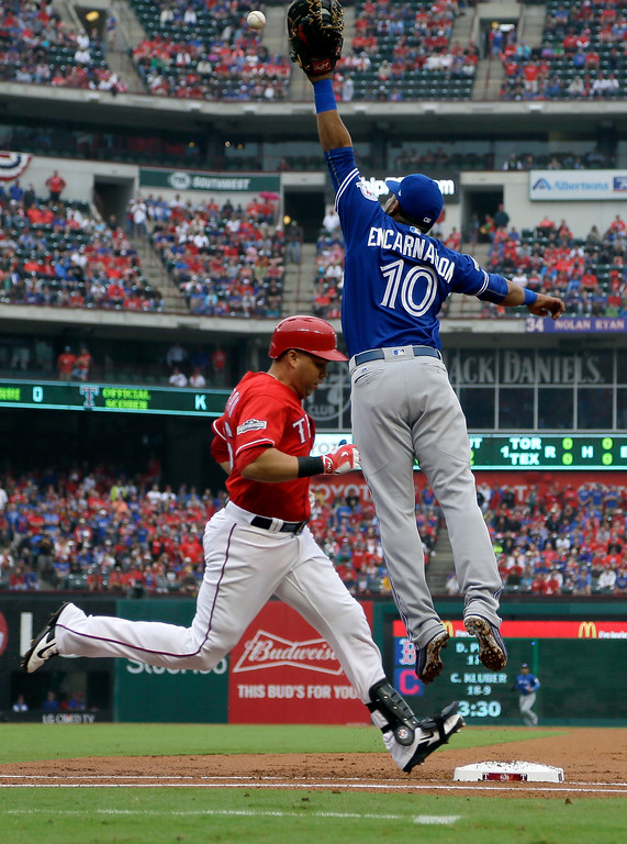 . Texas Rangers\' Carlos Beltran reaches first safely as Toronto Blue Jays first baseman Edwin Encarnacion (10) leaps to catch the throw to the bag in the first inning of Game 2 of baseball\'s American League Division Series, Friday, Oct. 7, 2016, in Arlington, Texas. (AP Photo/David J. Phillip)