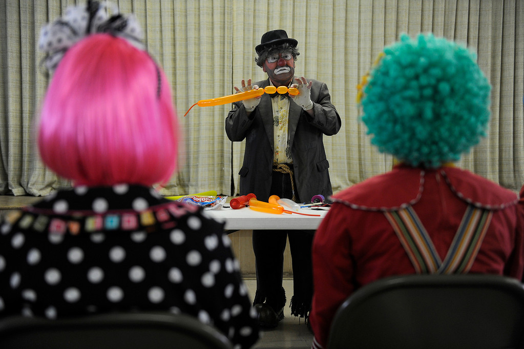 . Retread, aka Bernie Lopez, teaches students how to make a balloon animal during Clown Class at First Presbyterian Church in Englewood on Sunday, March 3, 2013. The Colorado Clowns presented the 10-week series of classes that taught participants how to apply make up, character development, skits, parades and the history of clowning. Seth A. McConnell, YourHub