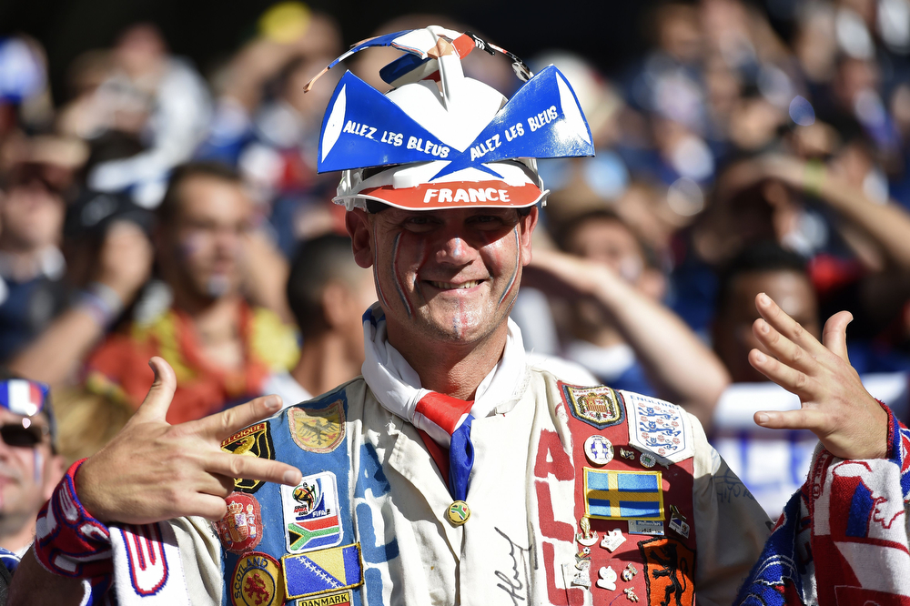 . A French fan gestures before a Group E football match between Switzerland and France at the Fonte Nova Arena in Salvador during the 2014 FIFA World Cup on June 20, 2014.  (FRANCK FIFE/AFP/Getty Images)