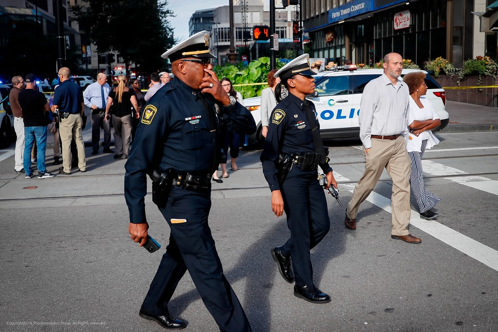 . Emergency personnel and police respond to a reported active shooter situation near Fountain Square, Thursday, Sept. 6, 2018, in downtown Cincinnati. (AP Photo/John Minchillo)