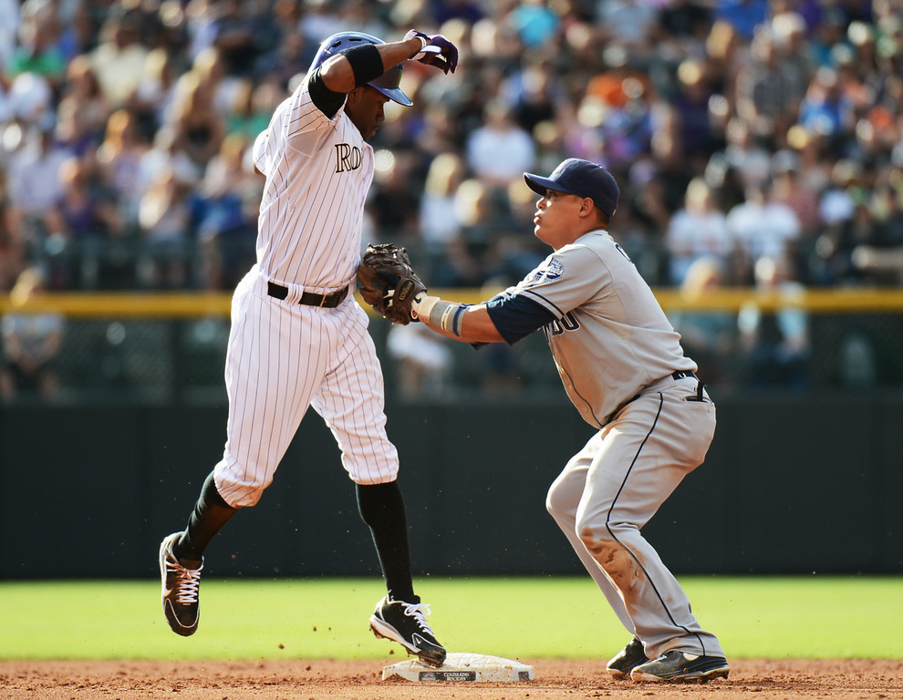 . Denver, CO. - June 08: Eric Young of Colorado Rockies (1) succeed steal 2nd base from Everth Cabrera of San Diego Padres (2) in the 3rd inning of the game at Coors Field. Denver, Colorado. June 8, 2013.  (Photo By Hyoung Chang/The Denver Post)
