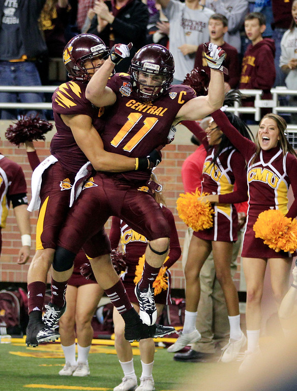 . Central Michigan wide receiver Cody Wilson (11) celebrate his fourth-quarter touchdown with a teammate in the Little Caesars Pizza Bowl NCAA college football game against Western Kentucky at Ford Field in Detroit, Wednesday, Dec. 26, 2012. Central Michigan won 24-21. (AP Photo/Carlos Osorio)