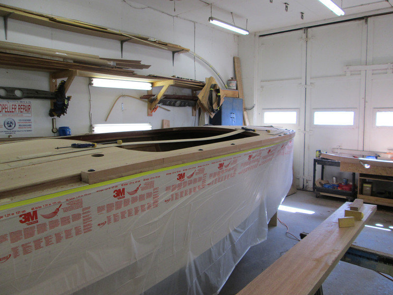 Center section of starboard cover board being fit.