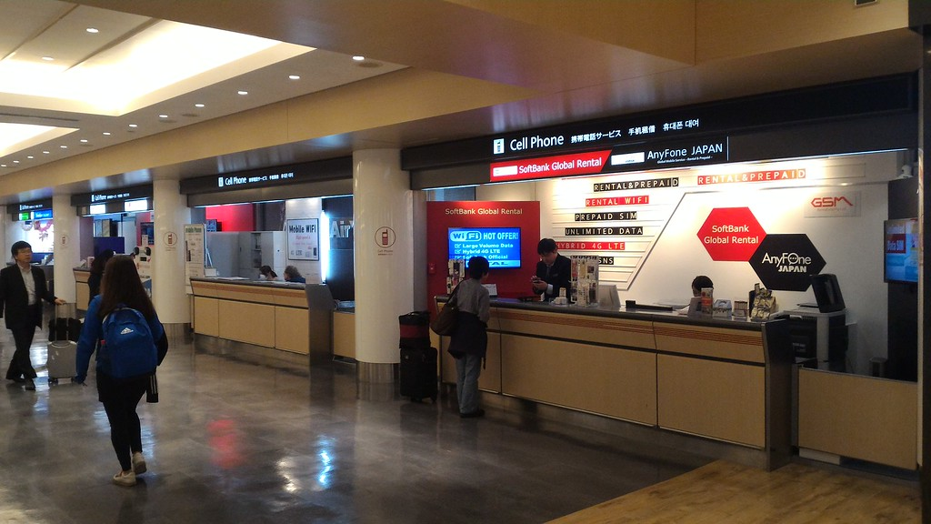 Cell phone and SIM counters in arrivals hall
