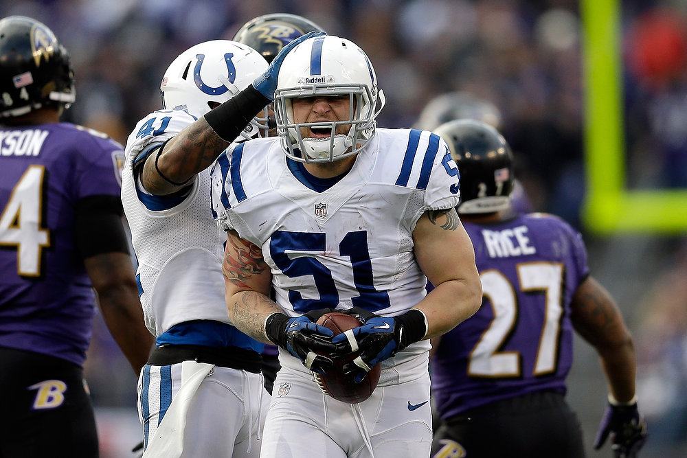 . Pat Angerer #51 of the Indianapolis Colts reacts after he recovered a fumble in the second half against the Baltimore Ravens during the AFC Wild Card Playoff Game at M&T Bank Stadium on January 6, 2013 in Baltimore, Maryland.  (Photo by Rob Carr/Getty Images)