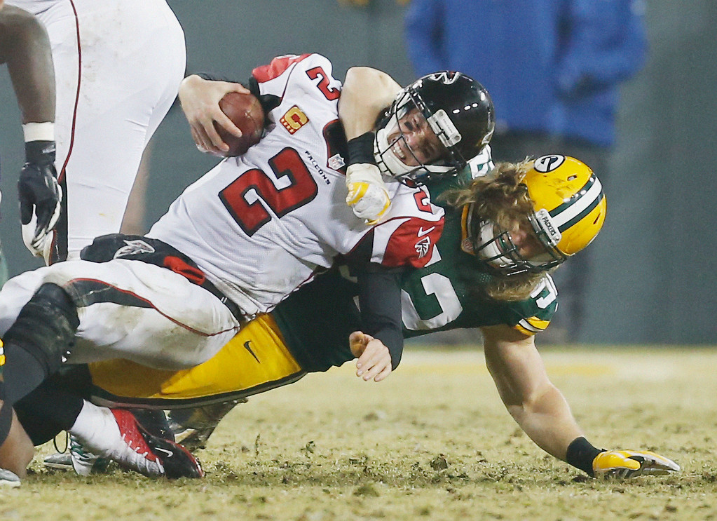 . Green Bay Packers\' Clay Matthews sacks Atlanta Falcons\' Matt Ryan during the second half of an NFL football game Monday, Dec. 8, 2014, in Green Bay, Wis. (AP Photo/Mike Roemer)