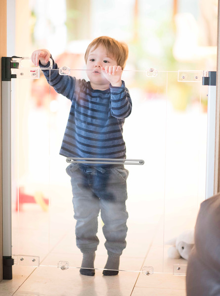 Fred_Stairgates_Screw_Fit_Clear_view_Gate_Lifestyle_toddler_behind.jpg