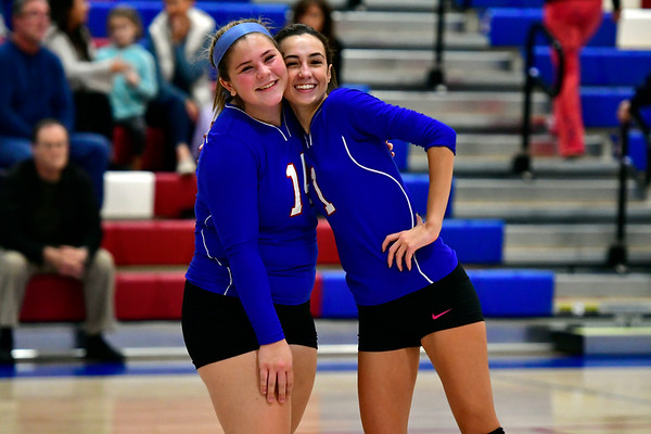 11/7/2018 Mike Orazzi | Staff St. Paul Catholic High School's Megan Fortier (14) and Juliette Russo (1) during the Class S Second Round Girls Volleyball Tournament with Immaculate in Bristol Wednesday night.
