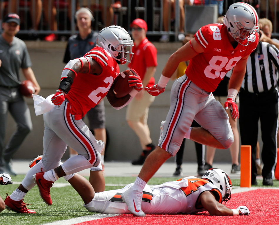 . Ohio State running back Mike Weber, left, follows teammate tight end Luke Farrell into the end zone against Oregon State during the first half of an NCAA college football game Saturday, Sept. 1, 2018, in Columbus, Ohio. (AP Photo/Jay LaPrete)