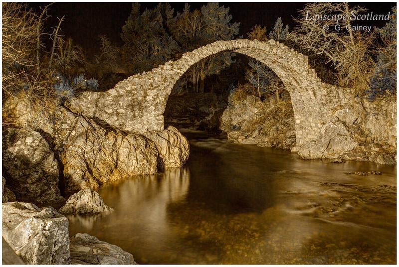 The old packhorse bridge, Carrbridge, floodlit at night